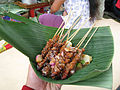 Chicken satay on banana leaf in Java.jpg