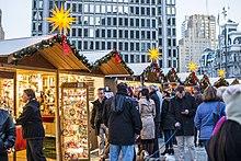 shoppers at christmas village in philadelphia in love park