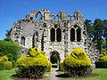 Cloister garden, Wenlock Priory.jpg