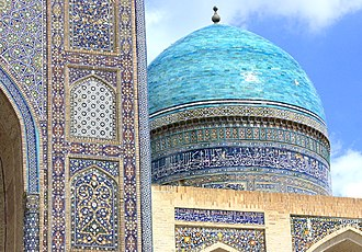 Po-i-Kalyan - A view of intricate tile-work on the Mir-i-Arab Madrasa in Bukhara, Uzbekistan.