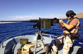 Coast Guard sailor points 50 caliber MG -- Guantanamo.JPG