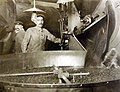 Coffee falling from the roasting machine into a cooler, Essonnes, France, 1918 (32147807935).jpg