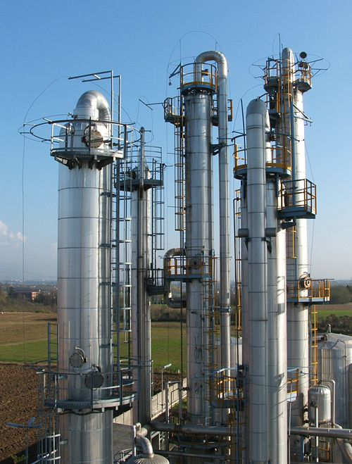 Chemical engineers design, construct and operate process plants (fractionating columns pictured).