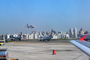 English: Jetplanes queuing for take off at Con...