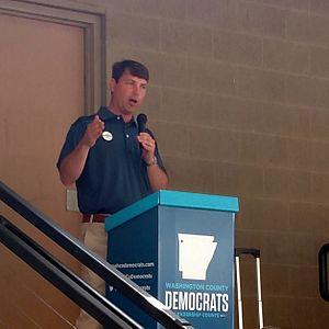 Conner Eldridge - Eldridge addresses a crowd at a Washington County Democrats rally at Shiloh Square in Springdale.
