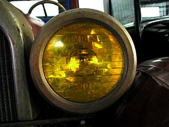 "Headlamp - One of the first optical headlamp lenses, the Corning Conaphore. Selective yellow ""Noviol"" glass version shown."