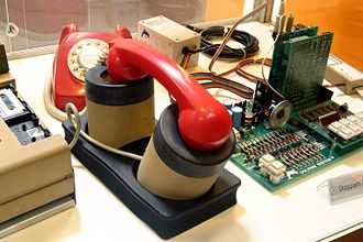 CXR Anderson Jacobson - Telephone being used with an acoustic coupler