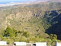 Crater of Bandama - a man lives and supplies himself down there - panoramio.jpg