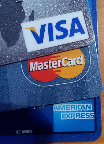 Visa, MasterCard, American Express are card-issuing entities that set transaction terms for merchants, card-issuing banks, and acquiring banks. Credit card logos (2015-12-1816-27-350044).jpg