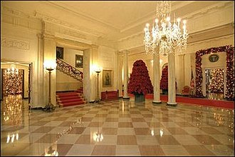 Grand Staircase (White House) - White House Entrance Hall at Christmastime during George W. Bush's administration with the Grand Staircase on the left.