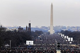 View of the entire length of the National Mall and the Washington Monument with a large audience of attendees