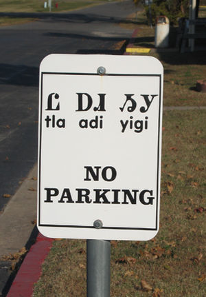 "Cherokee County, Oklahoma - Cherokee traffic sign in Tahlequah, Oklahoma, reading ""tla adi yigi"", meaning ""no parking"" from ""tla"" meaning ""no"""
