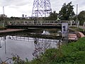Cyclists crossing the Exeter Canal on the swing bridge - geograph.org.uk - 1018864.jpg