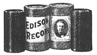 Two Edison cylinder records (on either end) and their cardboard storage cartons (center).