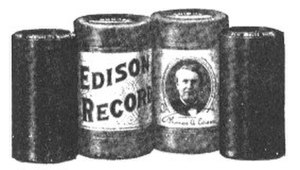Phonograph cylinder - Two Edison cylinder records (left and right) and their cylindrical cardboard boxes (center)