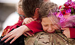 Deployed Airman embraces daughters 150422-F-GK926-056.jpg