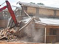 Destruction of 1940's barracks in Longview, Texas.jpg