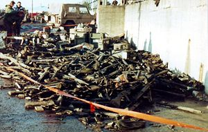Argentine surrender in the Falklands War - A pile of discarded Argentine weapons in Port Stanley.