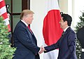 Donald Trump greeting Shinzo Abe at the gate 01.jpg