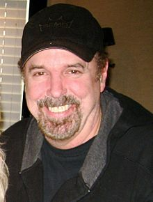 Eddie Bayers wearing a black baseball cap