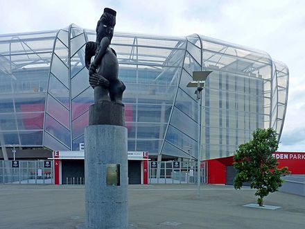 Eden Park stadium with statue of Rongomatane Eden Park with statue.jpg