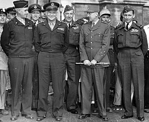 Marie-Pierre Kœnig - General Kœnig (holding baton) poses with Lieutenant General Omar Bradley, General Dwight D. Eisenhower and Air Chief Marshal Arthur Tedder in Paris, 1944