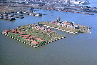 Ellis Island Immigrant Hospital - Ellis Island as seen from the air in the early 1970s, with the hospital at the southern (left) side of the island which had been created with landfill