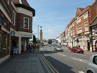 A24 road (England) - Epsom High street with the Ashley Centre and Epsom Clock Tower.