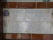A tablet formed of five tiles of varying sizes, bordered by yellow and blue flowers in an art nouveau style