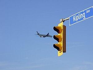 Kipling Avenue - An Etihad Airways jetliner descends above Kipling Avenue.
