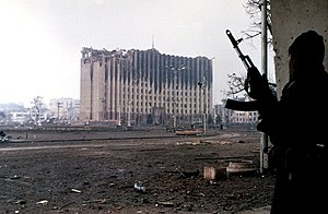 First Chechen War - A Chechen fighter near the burned-out ruins of the Presidential Palace in Grozny, January 1995