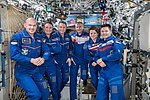 Expedition 57 crew gathers inside the Destiny laboratory.jpg