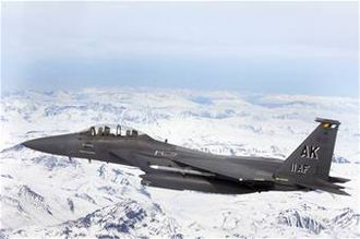 90th Fighter Squadron - A 90th FS F-15E Strike Eagle flies over glacial fields during a training mission.