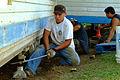 FEMA - 33024 - A volunteer group uses jacks to repair a damaged home in Hawaii.jpg