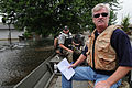 FEMA - 37356 - FEMA and local police inspecitng homes by boat in Wisconsin.jpg