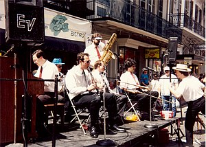 1993 in jazz - Band at French Quarter Festival, New Orleans. Visible musicians include Dan Levinson, clarinet; George Finola, cornet and leader; David Sager, trombone; Tom Saunders, bass sax. Tom McDermott in hat off stage comments to band