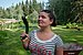 Female human being holding a homegrown zucchini in Quesnel, British Columbia (DSCF5368).jpg