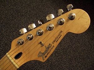 The headstock shape of the Stratocaster is tra...
