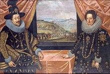 Un hombre y una mujer de pie en una mesa cerca de una ventana.