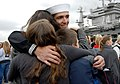 Flickr - Official U.S. Navy Imagery - A Sailor assigned to the aircraft carrier USS John C. Stennis embraces his family after returning from deployment..jpg