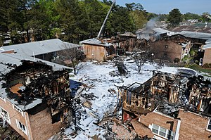 2012 Virginia Beach F/A-18 crash - Aerial view of damage to the Mayfair Mews apartment complex with tail section of the F/A-18D at center