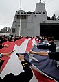 "Flickr - Official U.S. Navy Imagery - New York City firefighters and police officers fold the ""September 12th Flag"" with Sailors.jpg"