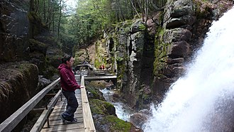 White Mountains (New Hampshire) - Tourists take in the Flume Gorge, part of Franconia Notch State Park in the White Mountains.