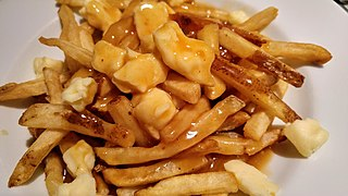 Poutine Québécois dish of french fries topped with cheese curds and gravy
