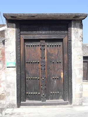 Swahili culture - Swahili Arabic script on Wooden door in Fort Jesus, Mombasa in Kenya