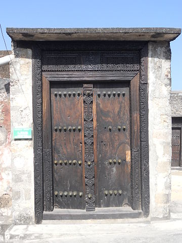 Swahili Arabic script on wooden door in Fort Jesus, Mombasa in Kenya