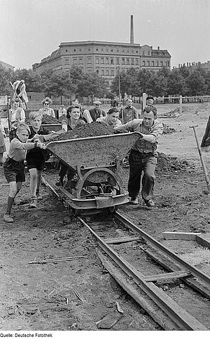 Zentralstadion (1956) - Workers are happy to have debris for their stadium: motivated, social, lack of food stuff and clothes