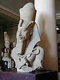 Statue of Akhenaten depicted in a style typical of the Amarna period, on display at the Museum of Egyptian Antiquities, Cairo
