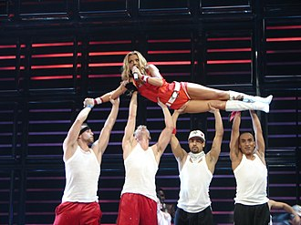 "Geri Halliwell - Halliwell performing ""It's Raining Men"", her last number-one single, on the Return of The Spice Girls Tour"