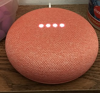 Google Home - A Coral-colored Home Mini, listening.